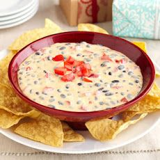 Easy-Five Mexican Dip Recipe Appetizers with Velveeta, philadelphia cream cheese, black beans, ground cumin, tomatoes, tortilla chips