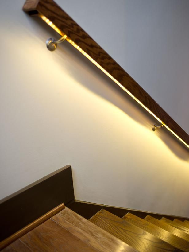 imagine how this looks at night...when the house is all quiet. LED light strips are inset into the hand rail to illuminate the stairs at night. Love it!