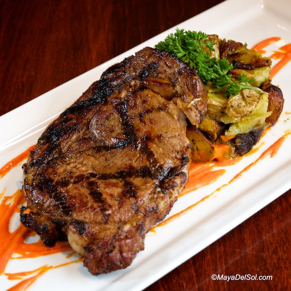 bistec a la parilla | ribeye, scallions, plantains, red bell pepper sauce