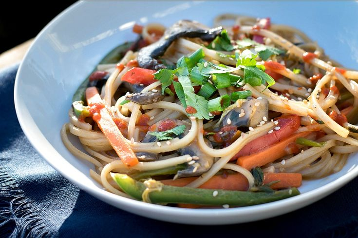 This week'srecipe: a Spicy Veggie Noodles Stir Fry!  Alright, they're not THAT spicy, but they are good and absolutely loaded with super healthy veggies and chewy rice noodles. Who says Stir-Frys have to be oily or dull?