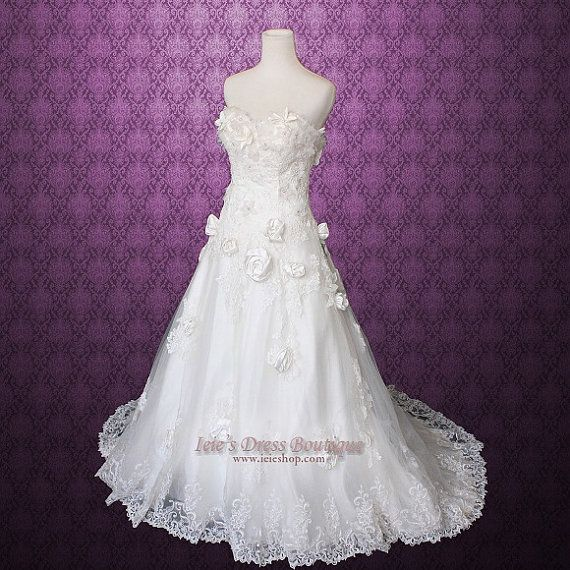 Size 4 Strapless Rosette Sweetheart Aline Wedding Dress by ieie, $699.95..incredibly perfect for that whimsical feel of a wooded or garden wedding