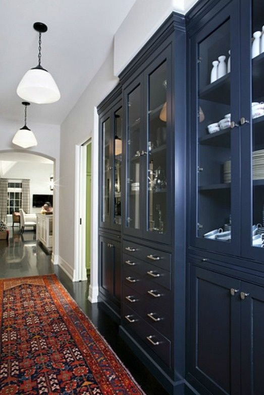 (BrandonRugs.com) The colorful Persian oriental runner was an inspired choice to make the blue hutch stand out in this hallway.