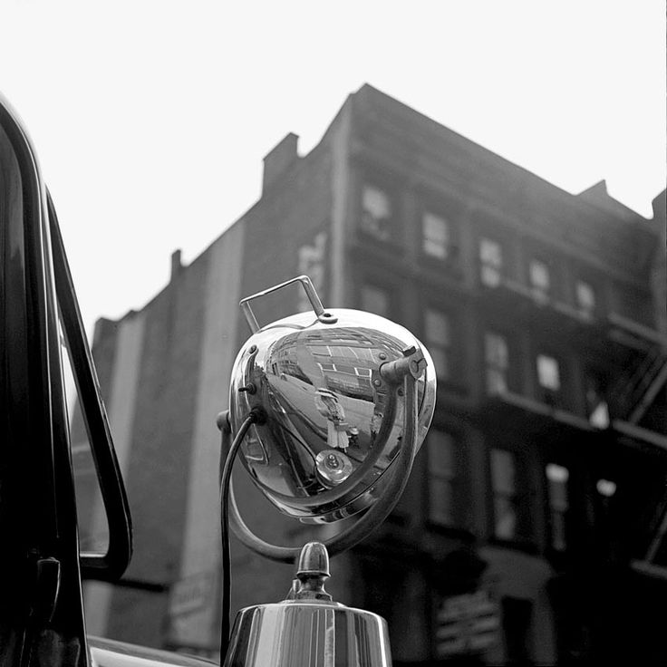 Vivian Maier - Self- portrait. Any reflective surface was too much temptation.