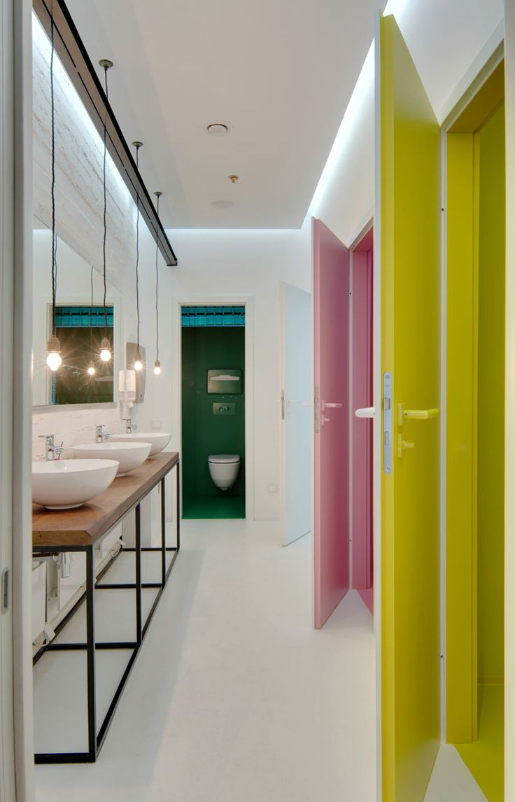 Create bold colour statements on the interior of he cubicals but keep the general space fairly simple