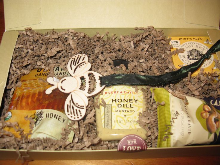 """Themed CHRISTMAS GIFT. The primary gift was a Bee Hive for a Family in Central America purchased through World Vision. The gift was given in honor of the Recipient.   I followed the """"BEE""""  theme and added Honey-themed favors: Honey mustard, Burt's Bees lip gloss, Honey Cough Drops, Honey cashews and a Bee Ornament."""