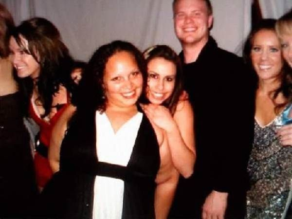 That awkward moment when you realize your friend's fat arm makes you look naked in the office Christmas party photo.