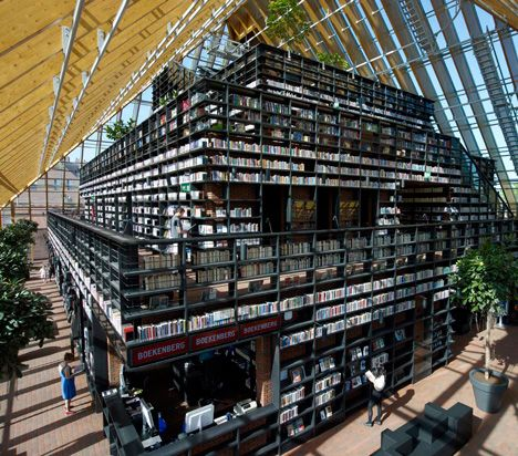 A tower of books is encased inside a glass pyramid at this public library Dutch firm MVRDV