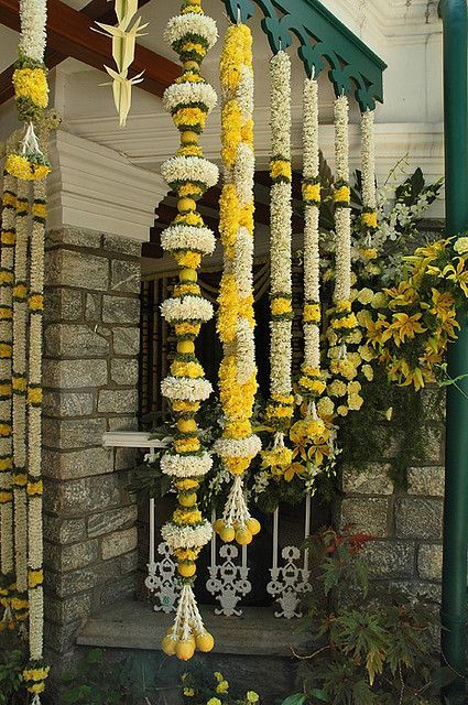 Traditional South Indian wedding decorations with flowers and lemon ----- #yellow #white #green: