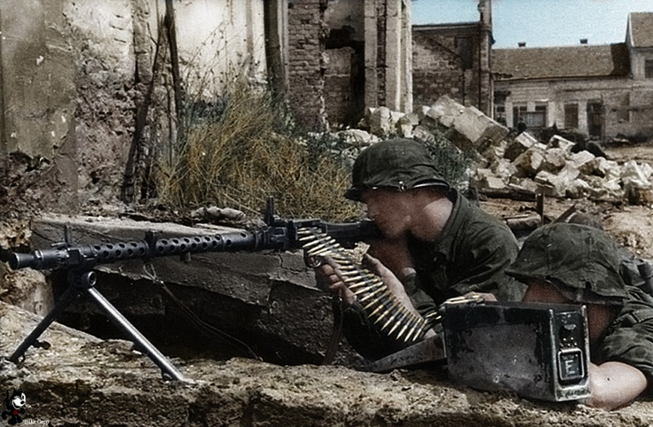 MG-34 gunners sit waiting.