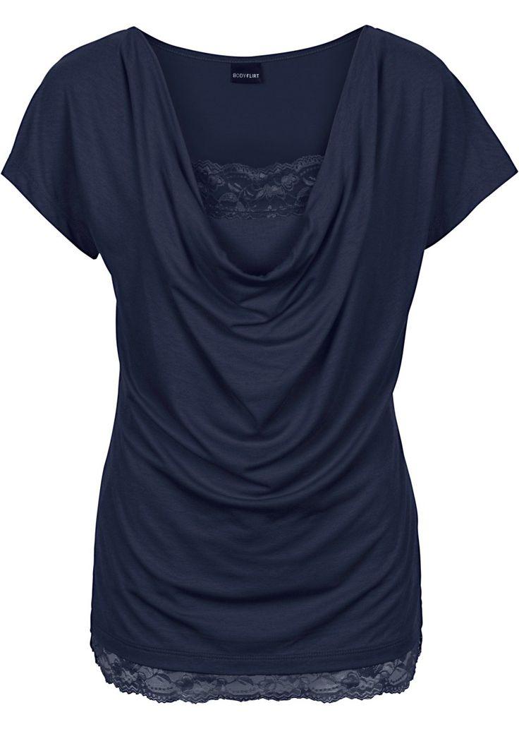 Bekijk nu:Modieus shirt van het merk BODYFLIRT met een watervalhals en kanten decoraties. Lengte in mt. 36/38 ca. 60 cm.