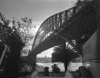Early morning view of Sydney Harbour Bridge, 1959. Photographer: John Tanner. NAA: A1200, L32608