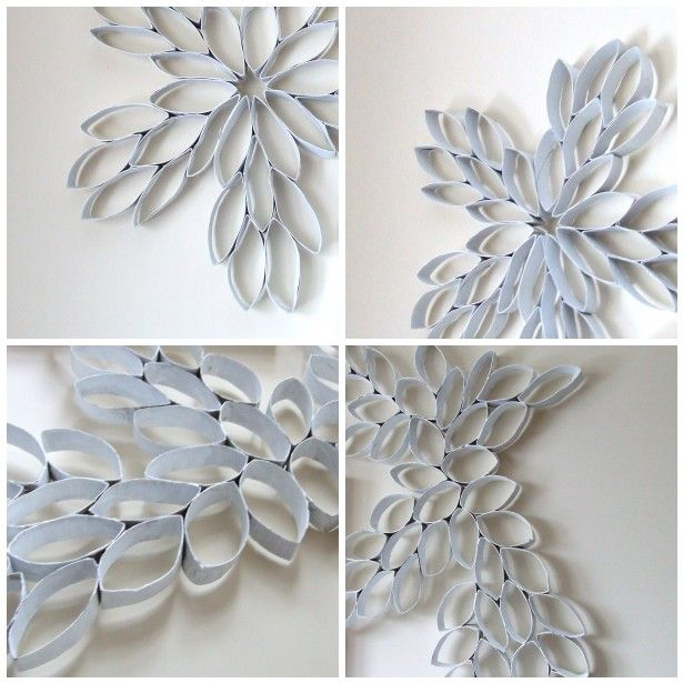 Cardboard tubes into wall art. Love this and so cheap. Spray paint what ever color you want. :)