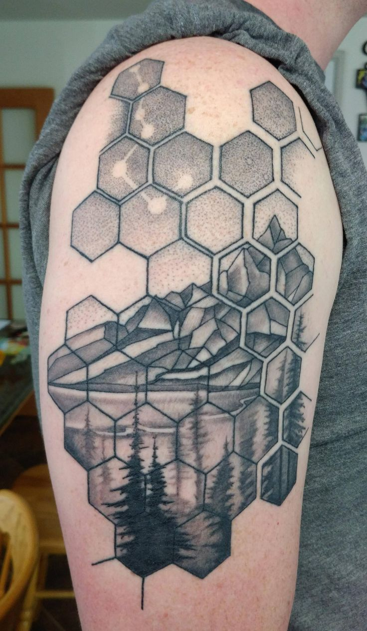 My first healed. Geometric pattern and landscape by Canyon Webb Reno Tattoo Company Reno NV