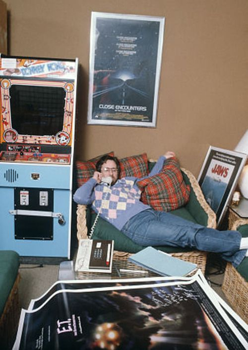 A vintage candid photo of Steven Spielberg hanging out in his office during the release of his 1982 film E.T.