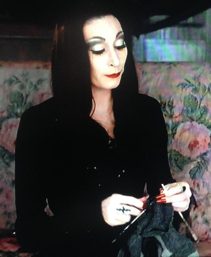 Morticia Addams (Anjelica Houston) Knitting for the little monsters.
