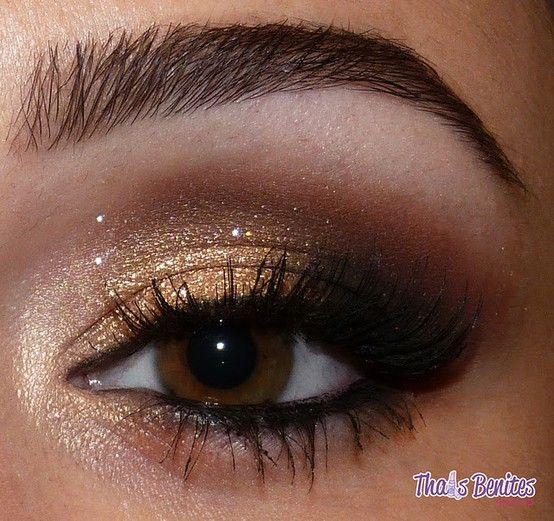 statement makeup - gold shadow- reverse for blue eyes: white/shimmer inner lid and nude to brown to dark brown to black in outer crease and near the browbone