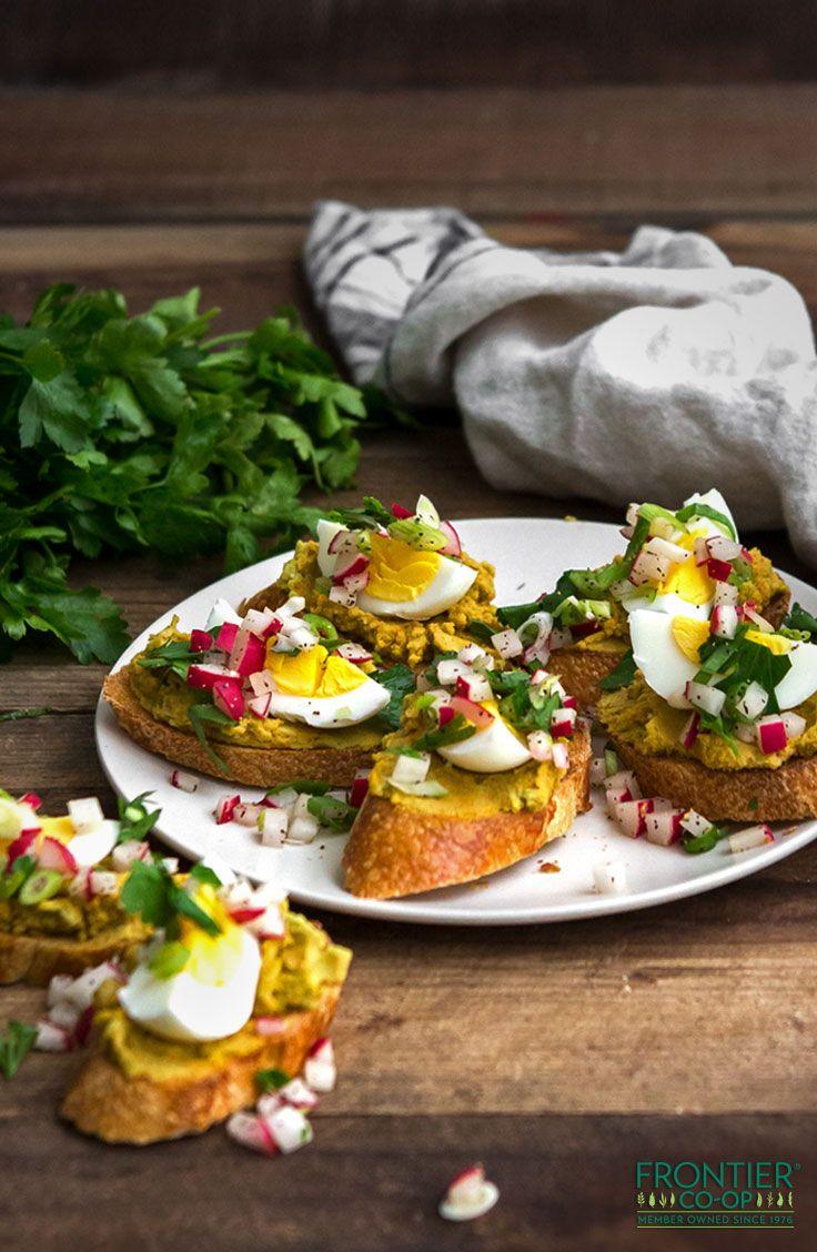 Fresh, spring split pea crostini topped with hardboiled egg wedges and a fresh radish relish.