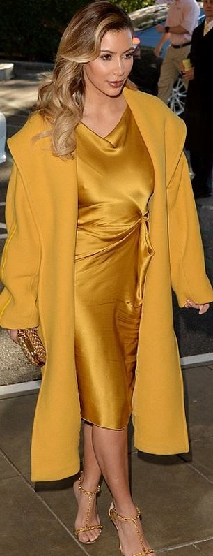 Who made  Kim Kardashian's yellow satin dress, gold chain sandals, yellow coat, and woven clutch handbag that she wore in Beverly Hills?