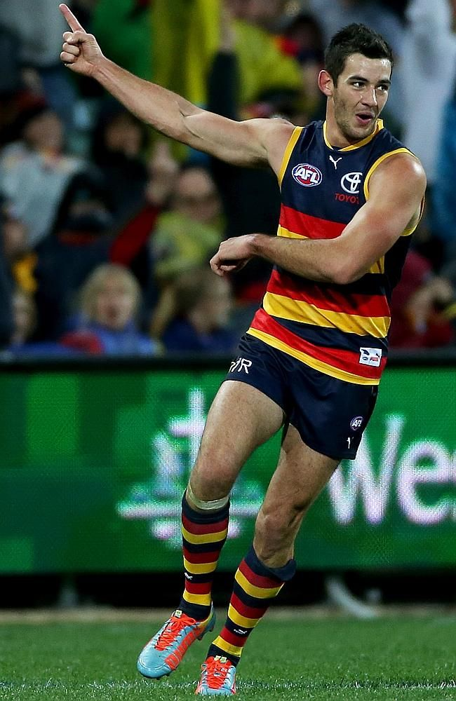 Crows star Taylor Walker celebrates his second goal to sink Port Adelaide. Picture: Simon