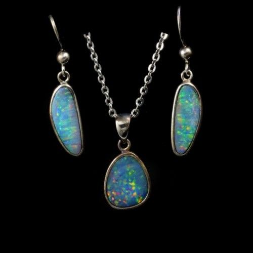 Opal Set 9015 Opal set with multi colored oranges and greens in sterling silver with surgical steel chain included https://opalmine.com/product/opal-set-9015/