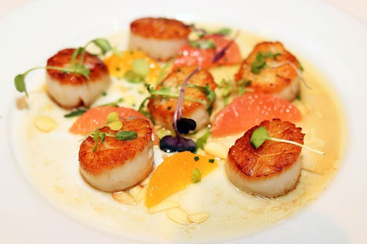 Eddie V's Prime Seafood | chicago foodie girl: Georges Bank Scallops sautéed with citrus fruit, roasted almonds, and brown butter