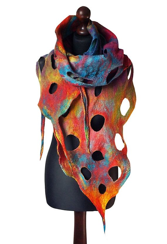 Felted scarf made from finest Australian merino wool. Lightweight and soft to the touch. Colors: multicolor - yellow, shades of red, shades of turquoise, purple, green.  Size: length: 199cm (78,35); with fringes 231cm (90,94) width: 24 - 33cm (9,45 - 12,99)  Visit my fan page on Facebook: www.facebook.com/pracownia.artystyczna.arteduo  More scarves you can find here: www.etsy.com/shop/MarlenaRakoczy?section_id=14901313&ref=shopsection_leftnav_1