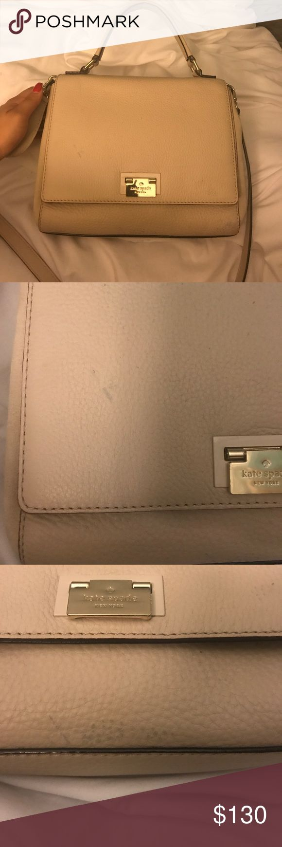 Kate Spade Crossbody Cream leather with suede on the sides. Gold hard ware in great shape, no tears or scratches. There is some color transfer towards the bottom as pictured and on the front. Inside looks brand new. Tory Burch Bags Crossbody Bags