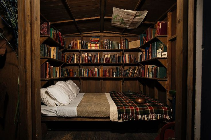 what if the guest bed was also a library!? this one's a bit dark, but I love the idea. NYC's Clandestine Cabin: The Lodge at Gallow Green: Remodelista