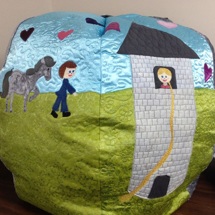 "My entry into the Taupo Quilt Makers 2014 Exhibition Quilt Challenge.  Theme was ""let it sparkle"".  I made a bean bag for my daughter Hayley based on fairytale hairdresser book Rapunzel - this is the day scene"