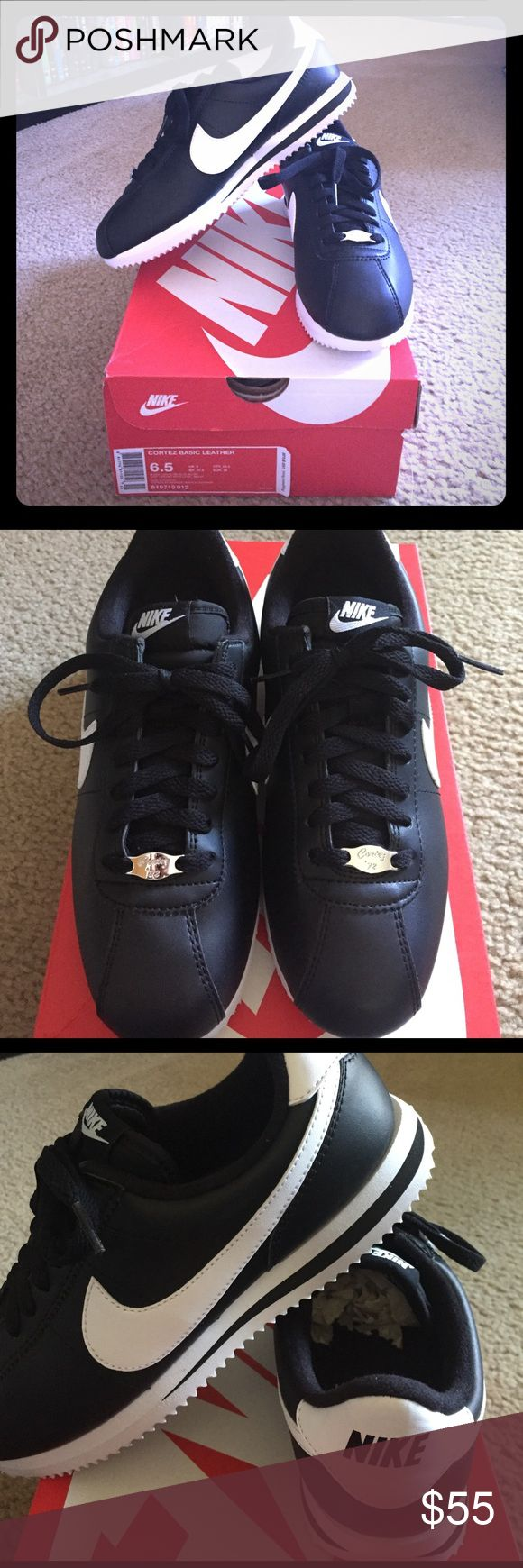 NIB! Nike Cortez Men's Sz. 6.5/ Wmn's Sz. 8 Brand new!  Nike Cortez black and white sneakers. Men's size 6.5 same as Women's size 8. These are a Nike classic! Wonderful shoes!! Nike Shoes Sneakers