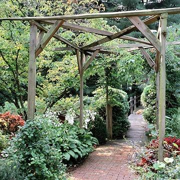rustic pergolas.  Idea to use split rail fence from a garden center.