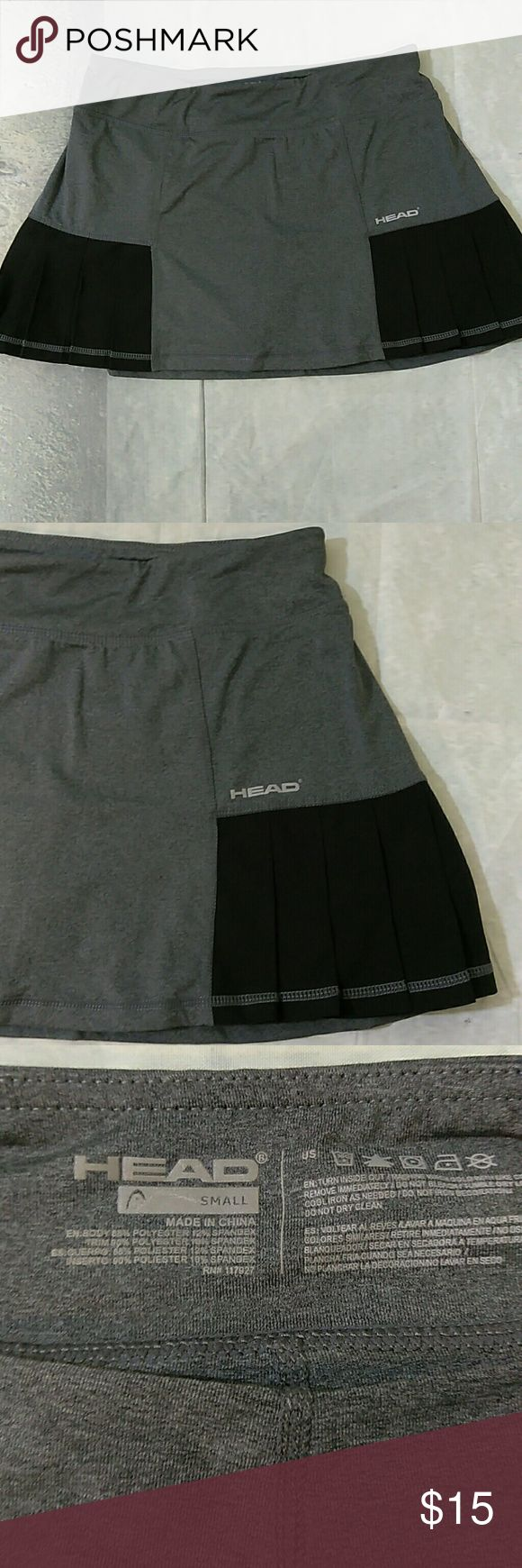 "Head Running Skort Cute black and gray skort with side pleats. Size small 88% Polyester 12% Spandex  Waist measures 13"" Overall Length 11.5""  Inseam in hidden short is 2.5""  Gently owned. No flaws.  Thank you! Head Shorts Skorts"