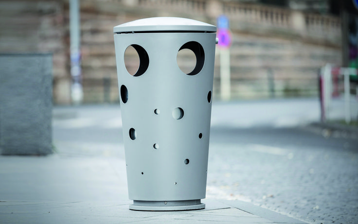 SWISSBIN by mmcité. Holes like in Emmental cheese, conical basic shape. It looks like a creative freak, but fully functional. The large-volume bin with small drop slots, allowing it to be used for small-size litter only, boasts outstanding stability thanks to a weight fixed in the bottom. www.mmcite.com