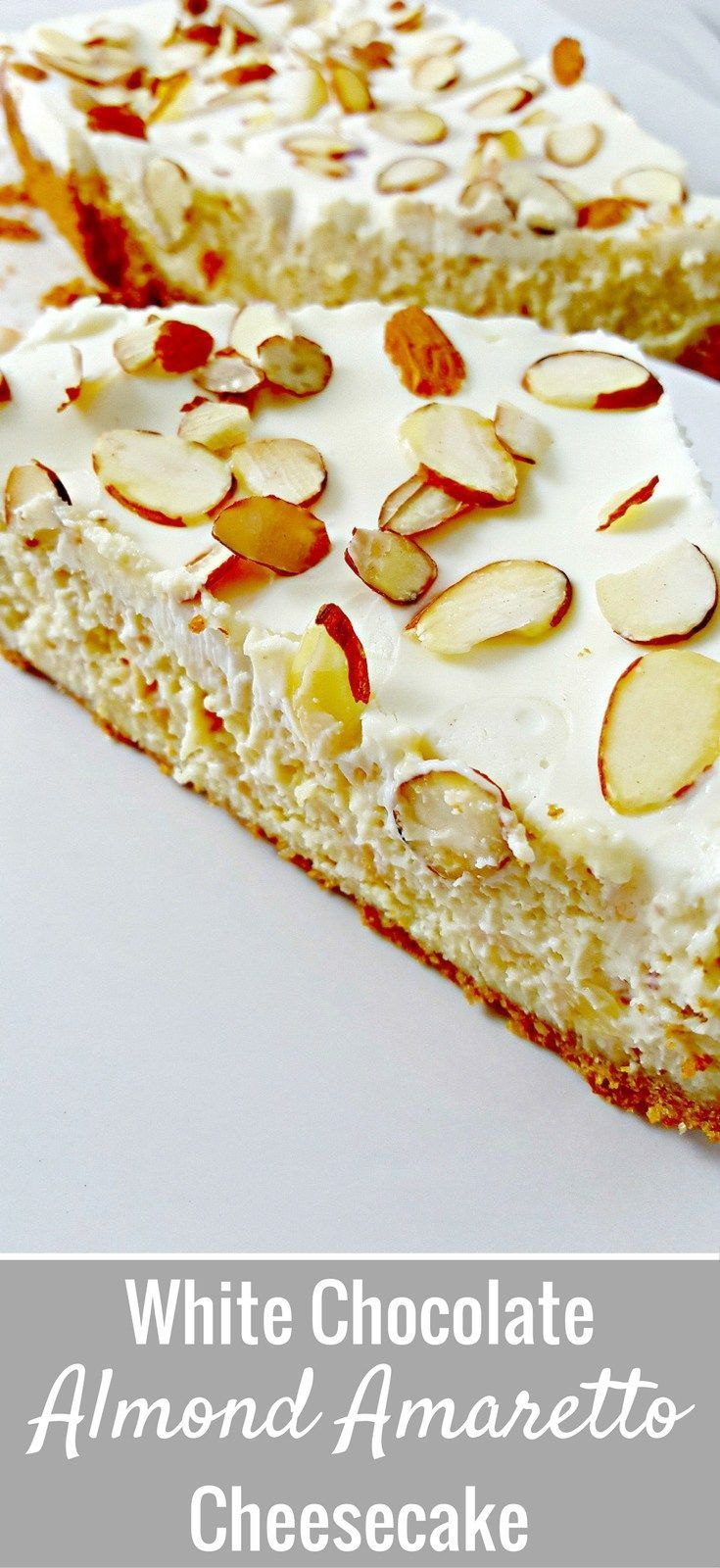 This elegant White Chocolate Almond Amaretto Cheesecake is gorgeous AND delicious! It starts with a homemade graham and almond crust. Then it's filled with a creamy dense cheesecake flavored with white chocolate, almond, and Amaretto. And finally, it is c