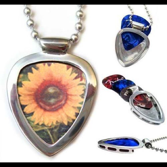 """Pickbay Guitar Pick Holder + Sunflower guitar pick Pickbay is the BEST gift set! Hypoallergenic Stainless steel PICKBAY guitar pick holder pendant necklace set comes with a Sunflower guitar pick plus 3+ cool guitar picks, a 24"""" hypoallergenic stainless steel bigger ball chain all packaged together in a velvet polishing pouch, ready for gift giving! The gift they will wear forever! Ships from Los Angeles. Pickbay.com Jewelry Necklaces"""