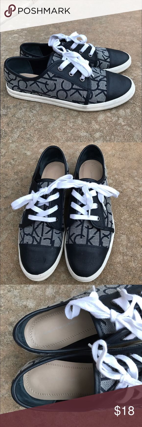 """Calvin Klein Merlinda Sneakers """"Merlinda"""" navy blue sneakers or tennis shoes size 7.5 in excellent condition. Only worn twice. Calvin Klein Shoes Sneakers"""