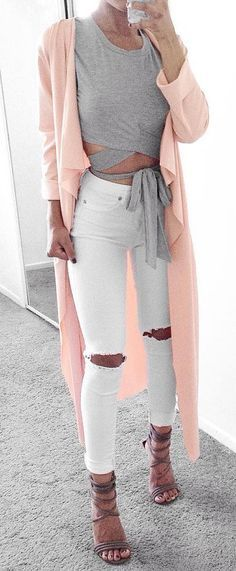 spring outfit ripped jeans + crossover top and a blush coat