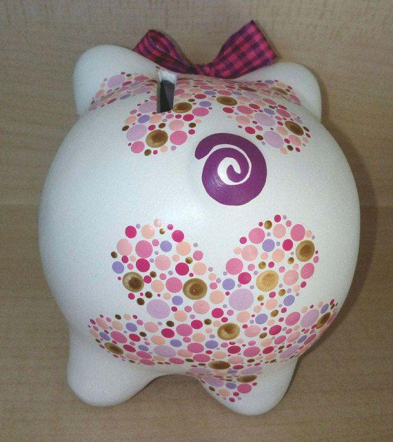 Acrylic hand-painted ceramic piggy bank. 4x4x4in aprox. Flower motifs. Original design. Design may slightly vary as each piggy bank is hand-painted individually.