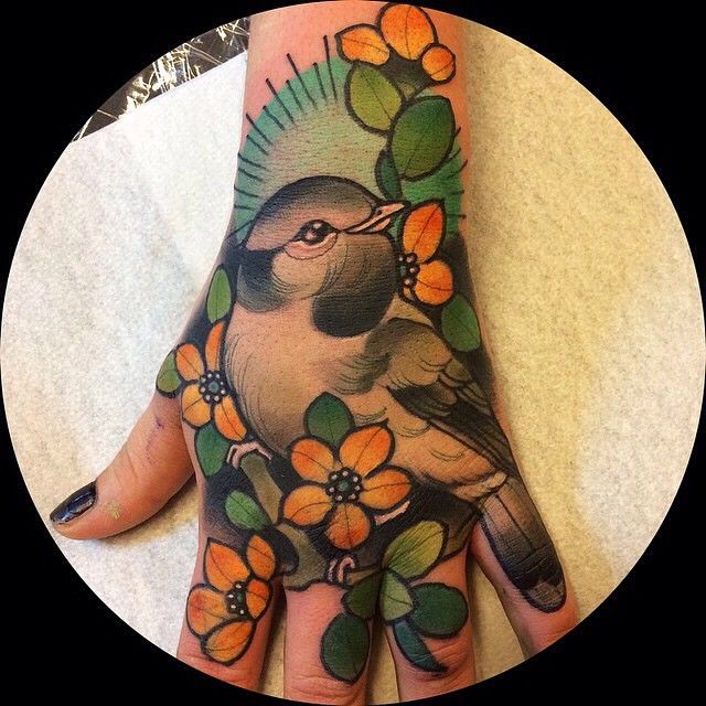 Bird and flower hand tattoo by karigrat in örebro, sweden
