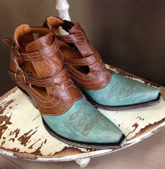 Lady cowboy boots in brass and aqua colors ...