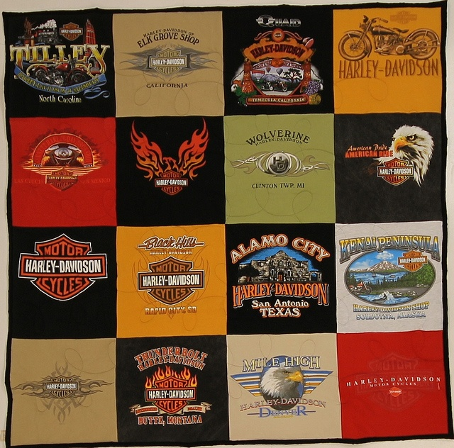 Create a great pattern of shirts using light and dark colors.  This one turned out so nice, it didn't need sashing!    16 sq. Stadium quilt with Black backing: Pattern, Photo