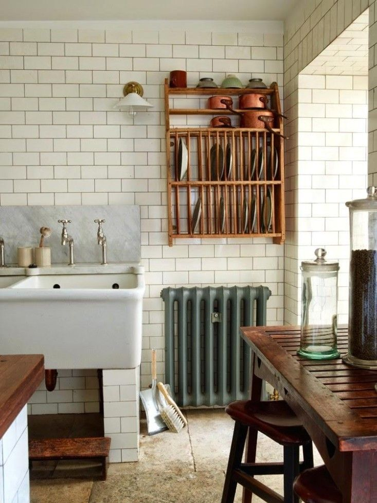 Kitchen with subway tiles and plate rack via Fleaing France | Remodelista