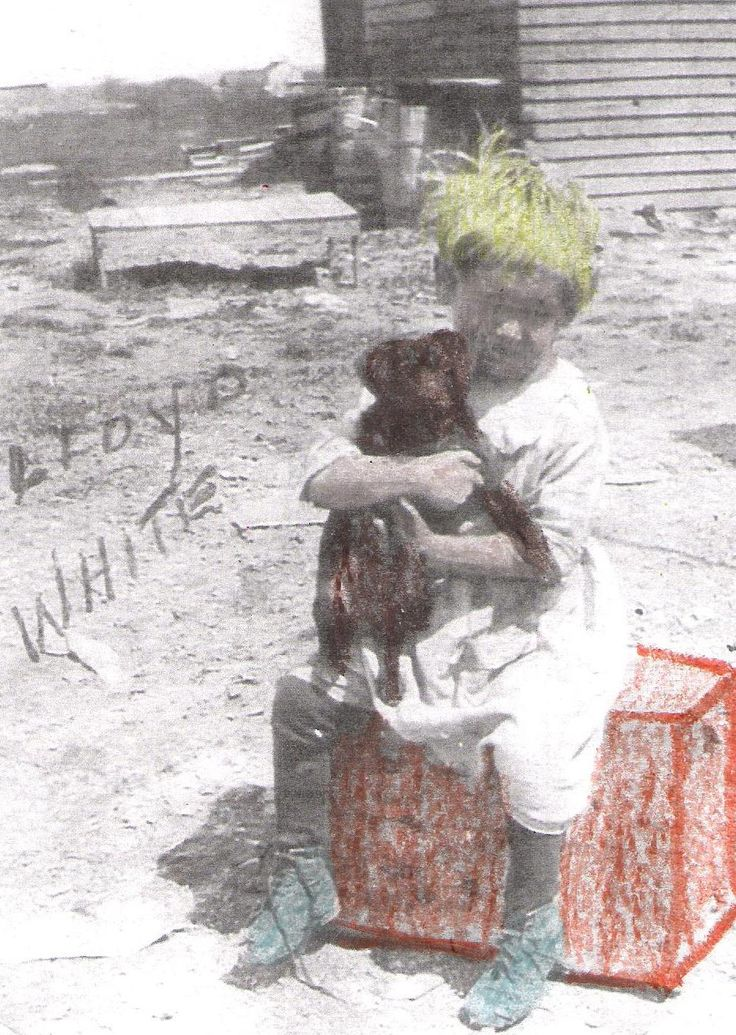 Photo of Lloyd White and a puppy. Kids add colour to black and white pictures
