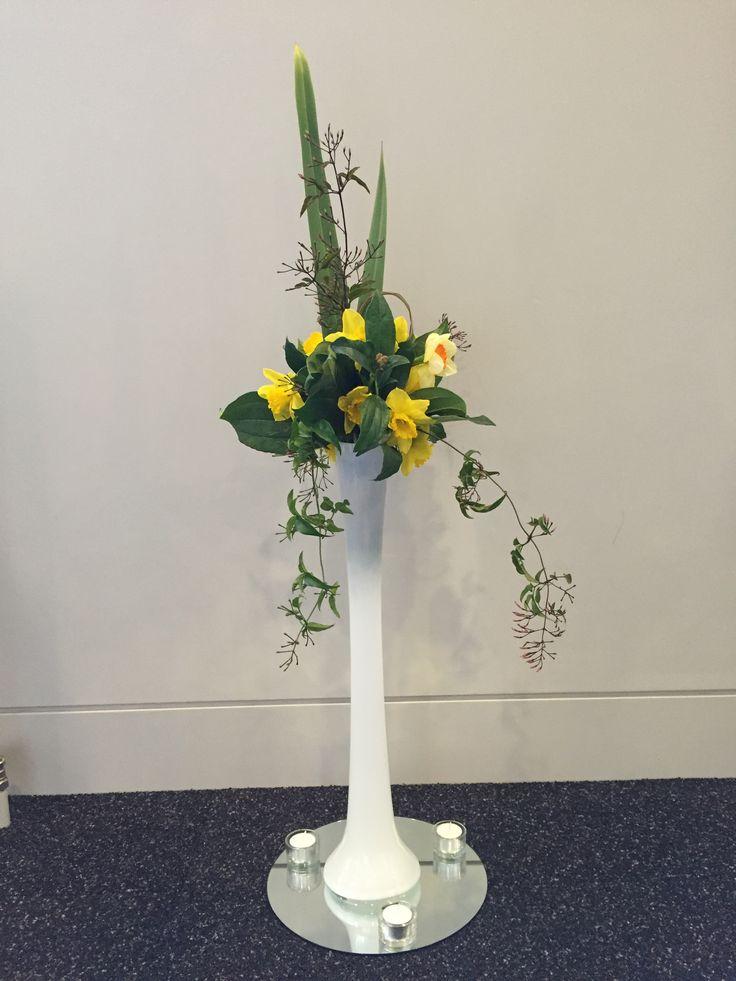 Eiffel tower vase with flowers http://wwwwanakaweddingflowers.co.nz/gallery/