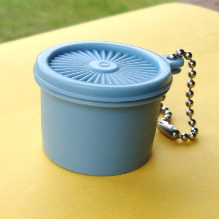 Vintage 1970's mini Tupperware container key chain. Free gift with purchase or hostess gift, I believe---my grandmother had one and kept change for pay phones and parking meters in it.