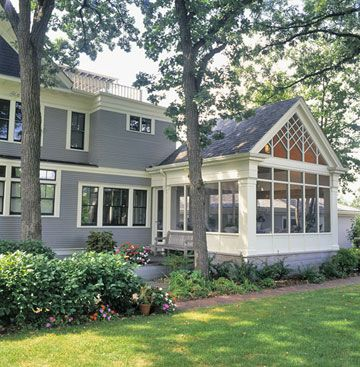 I wish I could just step into this picture!  I love the peeked roof on this sunroom and the fact that it is somewhat detached from the home but still compliments the style even though it's clearly it's own space. And the windows...WOW!