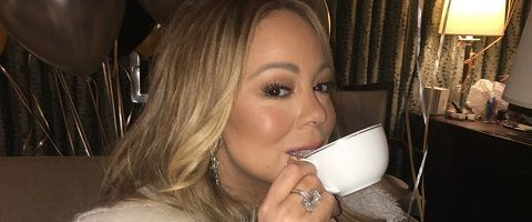 Mariah Carey sipping tea after performing New Year's Eve (she had earlier complained during her performance no tea was forthcoming)