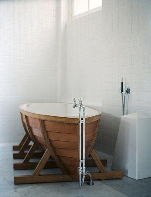 Nautical themed bathroom. Never seen a bathtub like this, but I love it.