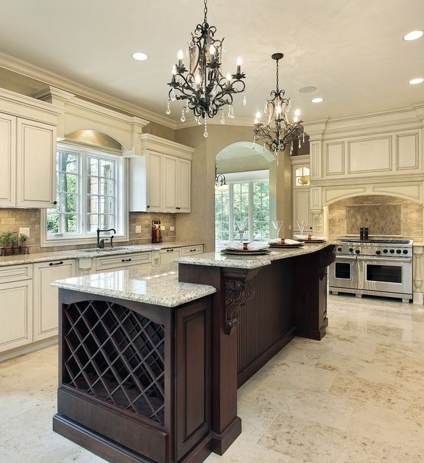 Incredible U-shaped white luxury custom kitchen with dark island (with built-in wine rack).
