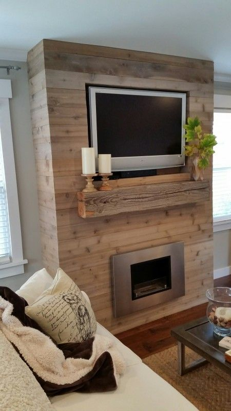 This DIY fireplace feature wall can be made on a budget, since you'll cut labor costs by constructing this one-of-a-kind piece yourself. The inexpensive statement piece uses repurposed wood to make a rustic yet modern display for this couple's home. Find out how they did it, and get ideas about how to build one of your own!